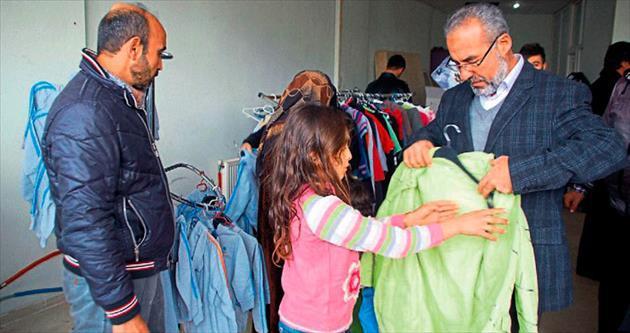 Suriyelilere kışlık giyecek yardımı
