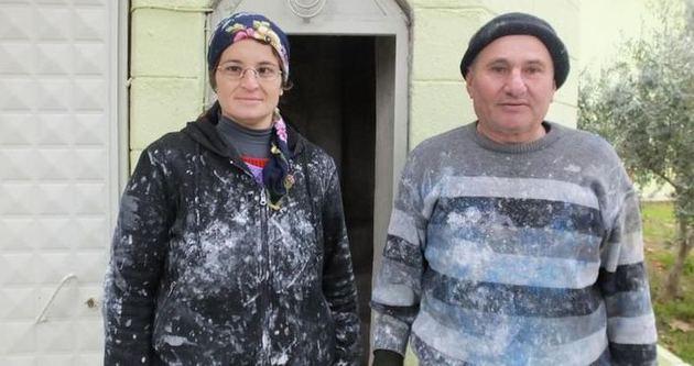 Kadın boyacı minare tepesinde ekmek parası kazanıyor