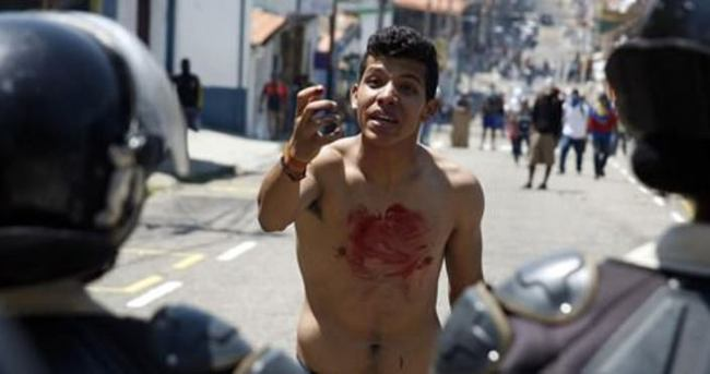 Venezuela'daki gösterilerde 14 yaşında genç öldü