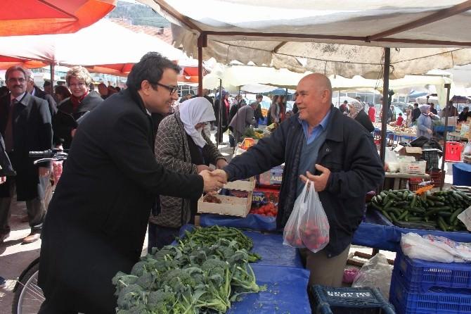 AK Aday Adayı Şakır, Bucak'ta Pazar Esnafını Ziyaret Etti