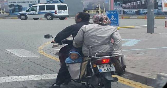 Motosiklet heybesinde tehlikeli yolculuk