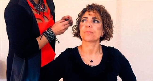 Kadına yönelik şiddete karşı 'makyajlı' eylem