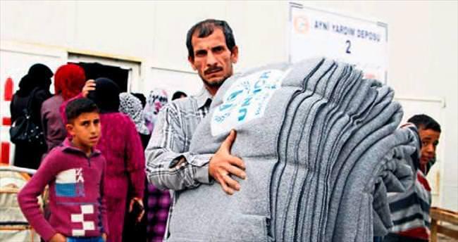 Battaniye yardımı Suriyelileri ısıttı