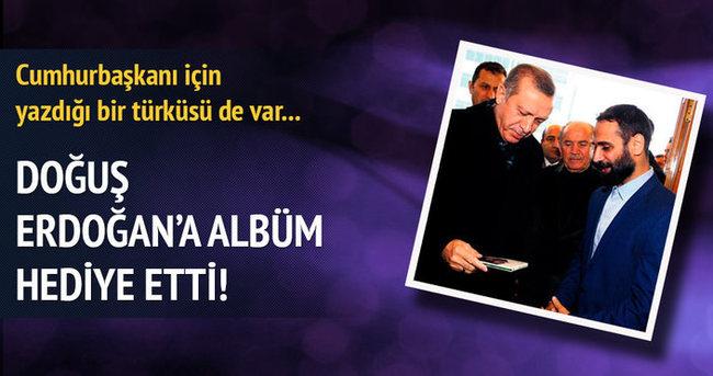 Doğuş, Erdoğan'a albüm hediye etti