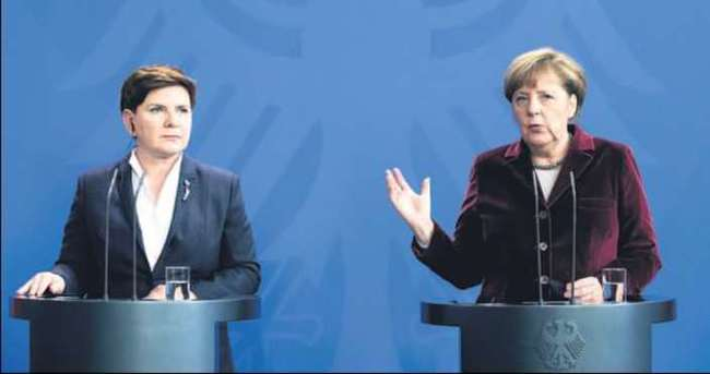 Merkel 'uçuşa yasak bölge'yi savundu