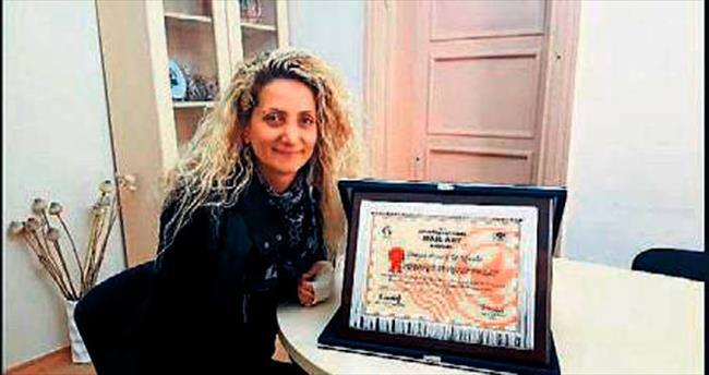 Öğretim Görevlisi Polat'a onur ödülü