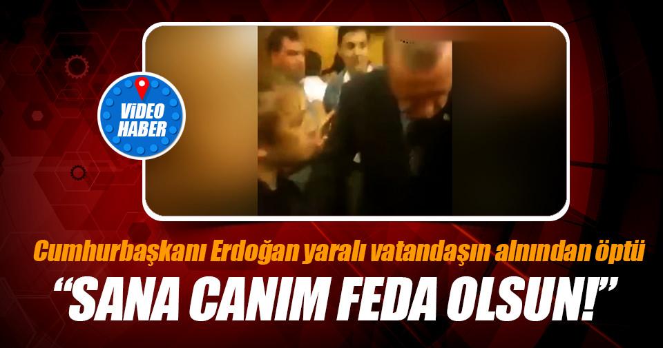 Cumhurbaşkanı Erdoğan yaralı vatandaşı alnından öpüyor