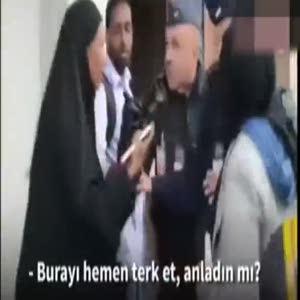 Fransız polisi çarşaflı kadını tartakladı!