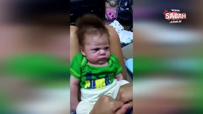 Asık suratlı bebeğin sevimliliği görenleri şaşırtıyor!